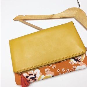 Rachel Pally floral clutch folded with a tassel